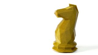 chess knight 3d printed in gold plastic