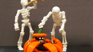 two skeletons and a pumpkin spider that are 3d printed